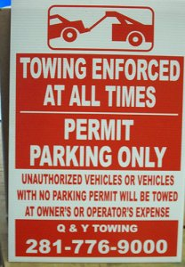 unauthorized parking sign towing enforced