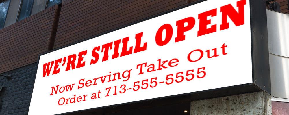 We're Still Open banner in Houston, TX