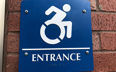 ADA braille signs for entrance
